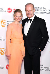 Kayte Walsh and Kelsey Grammer in the press room during the Virgin Media BAFTA TV awards, held at the Royal Festival Hall in London. Photo credit should read: Doug Peters/EMPICS