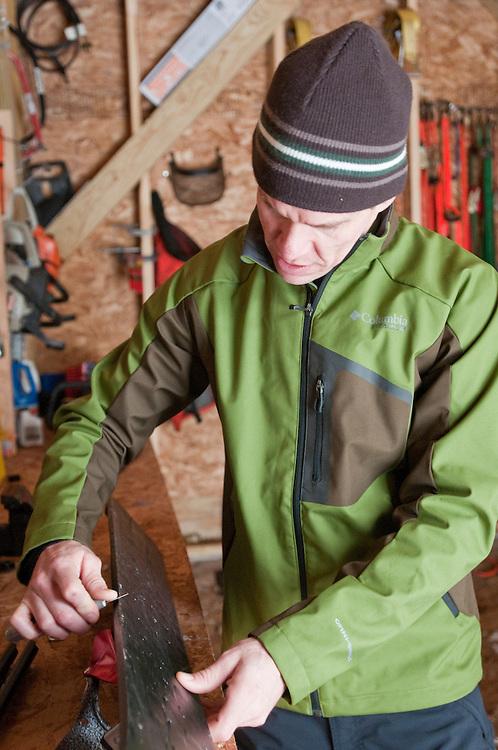 Inventor David Ollila demonstrates maintenance on his Marquette Backcountry Ski near Marquette Michigan.
