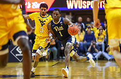 Dec 8, 2018; Morgantown, WV, USA; Pittsburgh Panthers guard Xavier Johnson (1) dribbles while guarded by West Virginia Mountaineers guard James Bolden (3) during the first half at WVU Coliseum. Mandatory Credit: Ben Queen-USA TODAY Sports