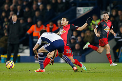 Jefferson Montero of Swansea City is challenged by Claudio Yacob of West Brom - Photo mandatory by-line: Rogan Thomson/JMP - 07966 386802 - 11/02/2015 - SPORT - FOOTBALL - West Bromwich, England - The Hawthorns - West Bromwich Albion v Swansea City - Barclays Premier League.