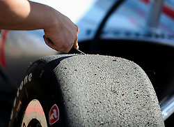 March 9, 2019 - St. Petersburg, Florida, U.S. - DIRK SHADD   |   Times  .Crew members work to clear debris from the surface of the tires of IndyCar driver Will Power in pit lane before an IndyCar practice session at the Grand Prix of St. Petersburg in St. Petersburg on Saturday, March 9, 2019. (Credit Image: © Dirk Shadd/Tampa Bay Times via ZUMA Wire)