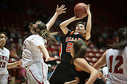 Gallup's Stacy Charley shoots over Roswell's Diana Carrillo. Gallup defeated Roswell 50-44 in the AAAA semifinals Thursday morning in Albuquerque at The Pit.