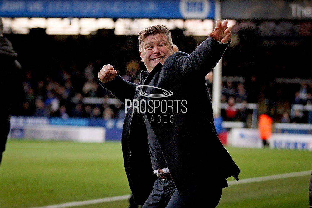 Oxford United's manager Karl Robinson celebrates his teams equaliser 1-1 during the EFL Sky Bet League 1 match between Peterborough United and Oxford United at London Road, Peterborough, England on 8 December 2018.