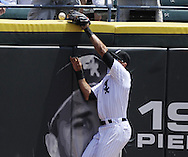 CHICAGO - JULY 06:  Alex Rios #51 of the Chicago White Sox leaps but cannot catch the home run ball hit by Eric Hosmer #35 of the Kansas City Royals in the second inning on July 6, 2011 at U.S. Cellular Field in Chicago, Illinois.  The Royals defeated the White Sox 4-1.  (Photo by Ron Vesely/MLB Photos via Getty Images)  *** Local Caption *** Alex Rios;Eric Hosmer
