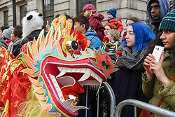 © Licensed to London News Pictures. 29/01/2017. London, UK.   The head of the dragon is seen as the Chinese New Year parade takes place around Chinatown to celebrate the Year of the Rooster. Photo credit : Stephen Chung/LNP
