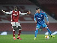 Football - 2020 / 201 UEFA Europa League - Round 16 - Second Leg - Arsenal vs Olympiakos - Emirates Stadium<br /> <br /> Oleg Reabciuk of Olympiacos and Nicolas Pepe of Arsenal<br /> <br /> <br /> Credit : COLORSPORT/ANDREW COWIE