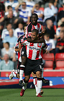 Photo: Lee Earle.<br /> Southampton v Queens Park Rangers. Coca Cola Championship. 30/09/2006. Southampton's Bradley Wright Phillips jumps on the back of Jermaine Wright after he scored their opening goal.