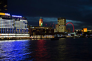 Night view across the River Thames towards the Oxo Tower, Sea Containers House, the National Theatre and the London Eye on the Southbank, London, United Kingdom. The South Bank is a significant arts and entertainment district, and home to an endless list of activities for Londoners, visitors and tourists alike.
