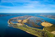 """Nederland, Zuid-Holland, Tiengemeten, 01-04-2016;  Het eiland Tiengemeten (abusieveelijke ook  Tiengemeenten) werd oorspronkelijk gebruikt voor de akkerbouw maar is inmiddels 'teruggegeven aan de natuur': de dijken zijn deels doorgestoken en de laatste boer is in 2006 vertrokken. De 'nieuwe natuur' vormt onderdeel van de Ecologische Hoofdstructuur.<br /> The island Tiengemeten in the Haringvliet, was originally used for agriculture but has now """"been given back to nature"""". Large parts have been flooded and the isle is part of the National Ecological Network. The last farmer left in 2006. Current use, among other, care farms and camping. luchtfoto (toeslag op standard tarieven);<br /> aerial photo (additional fee required);<br /> copyright foto/photo Siebe Swart"""