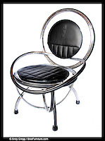 The S-2 Lounge / Office Chair is made from chromed steel rims...It is available with padded vinyl cushions, inner-tube upholstery, and cushions made from reused automotive upholstery.