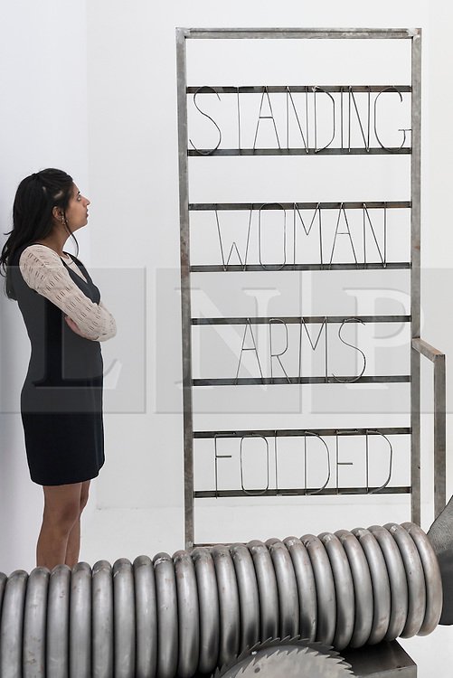 """© Licensed to London News Pictures. 22/06/2016. London, UK. A staff member looks at """"Q Love Stand In"""" by Kira Freije at the annual exhibition of works by artists graduating from the UK's longest established art school, RA Schools Show, at the Royal Academy in Piccadilly.  Works from 17 emerging artists are on show 23 June to 3 July. Photo credit : Stephen Chung/LNP"""