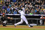 Carlos Gonzalez of the Colorado Rockies shatters his bat in a game against the Arizona Diamondbacks