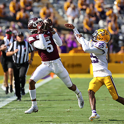 Sep 26, 2020; Baton Rouge, Louisiana, USA; Mississippi State Bulldogs wide receiver Osirus Mitchell (5) catches a pass over LSU Tigers cornerback Cordale Flott (25) during the first half at Tiger Stadium. Mandatory Credit: Derick E. Hingle-USA TODAY Sports