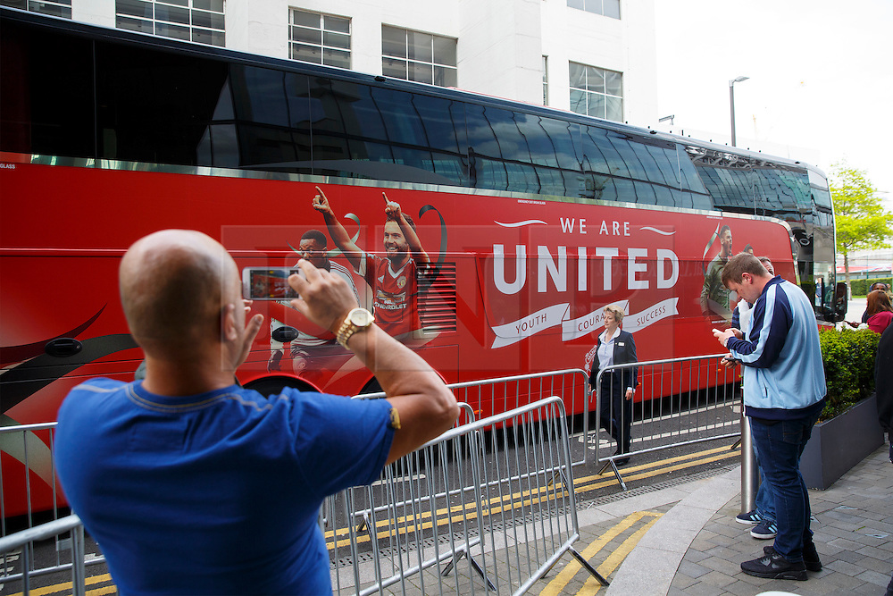 © Licensed to London News Pictures. 20/05/2016. London, UK. A fan takes pictures of the team bus whilst Manchester United players arriving at their hotel in Wembley, London on Friday, 20 May 2016, ahead of the FA Cup final against Crystal Palace in Wembley Stadium. Photo credit: Tolga Akmen/LNP
