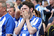 a Sheffield Wednesday fan looks on dejected after full time. Skybet football league Championship play off final match, Hull city v Sheffield Wednesday at Wembley Stadium in London on Saturday 28th May 2016.<br /> pic by John Patrick Fletcher, Andrew Orchard sports photography.
