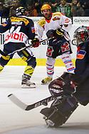 29.03.2011, Kloten, Eishockey NLA Playoff, Kloten-Flyers - SC Bern, Matthias Bieber (l) und Torhueter Ronnie Rueger (KLO) gegen Christian Dube (BER)  (Thomas Oswald/hockeypics)