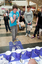 "Cadburys Spots vs Stripes Challenge Race Season Meadowhall Sheffield.Troy Butler goes for the ""Fastest Tea Maker"".2 April 2011.Images © Paul David Drabble"