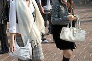 close up of two urban chic girls walking through Tokyo Japan