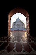 Taj Mahal mausoleum western view viewed from Taj Mahal Mosque with its prayer mat floor tiles at dawn, Uttar Pradesh, India