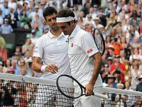 Tennis - 2019 Wimbledon Championships - Week Two, Sunday (Day Thirteen)<br /> <br /> Men's Singles, Final: Novak Djokovic (SRB) vs. Roger Federer (SUI)<br /> <br /> Novak Djokovic condoles Federer at the net after the match, on Centre Court.<br /> <br /> COLORSPORT/ANDREW COWIE