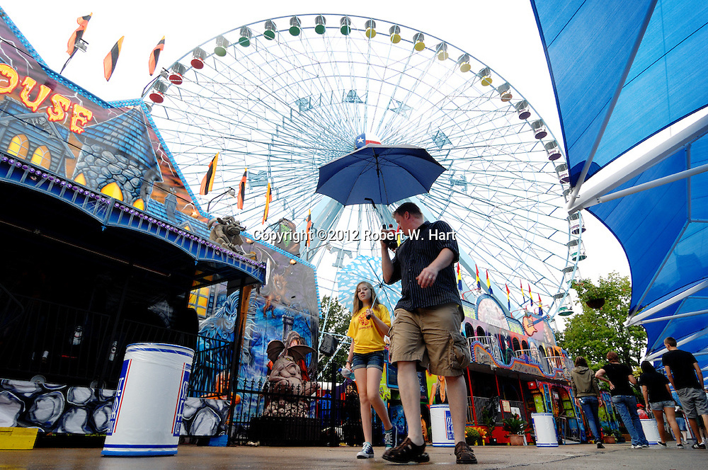 A father and daughter walk down the Midway of the State Fair of Texas on September 25, 2010, in Dallas, Texas...(Robert W. Hart/Special Contributor)