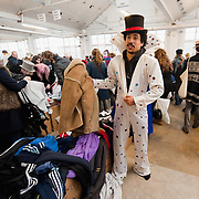 """LONDON, ENGLAND - FEBRUARY 06:  A customer tries on an """"Elvi""""s outfit at Angels Retro Sale on February 6, 2010 in London, England. Angels Costumiers are selling over 25,000 items of clothing and accessories from their warehouse in Wembley on February 6, 2010. The Retro Sale features fashion items from the 1950s to the 1990s as well as period military uniforms. Angels is the world's longest-established supplier of costumes to film and theatre, founded in 1840 the company supplies costumes to over 1000 productions per year.  (Photo by Marco Secchi/Getty Images)"""