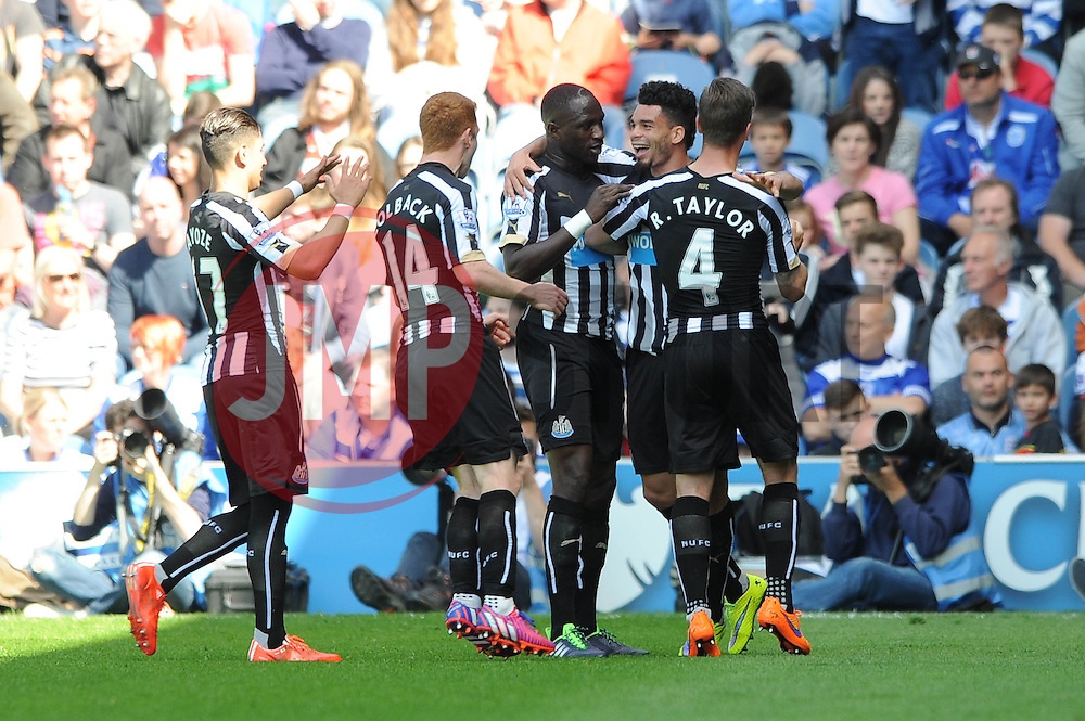 Newcastle United's Emmanuel Riviere celebrates with his team mates after scoring - Photo mandatory by-line: Dougie Allward/JMP - Mobile: 07966 386802 - 16/05/2015 - SPORT - football - London - Loftus Road - QPR v Newcastle United - Barclays Premier League