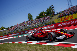 July 29, 2017 - Budapest, Hungary - Ferrari's SEBASTIAN VETTEL took pole position for the Hungarian Grand Prix heading a Ferrari one-two as title rival Hamilton struggled in fourth during qualifying for FIA Grand Prix of Hungary. (Credit Image: © Hoch Zwei via ZUMA Wire)