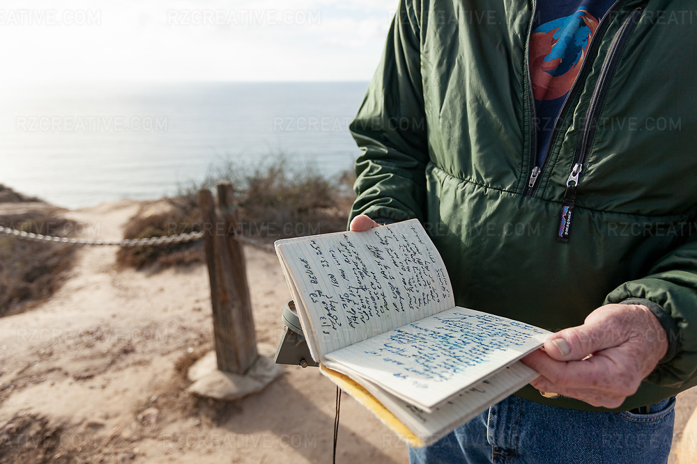 Paddler Ed Gillet holds a sextant which he used for navigation and the journal he kept while at sea during a 64 day, 2,200 mile kayak crossing from Monterey, CA to Maui, HI. Photo © Robert Zaleski / rzcreative.com<br /> —<br /> To license this image contact: robert@rzcreative.com