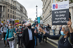 John McDonnell, Labour MP for Hayes and Harlington, joins NHS workers and supporters taking part in a protest march from University College Hospital (UCH) to Whitehall as part of a national day of action to mark the 73rd birthday of the National Health Service on 3rd July 2021 in London, United Kingdom. The protesters called for fair pay for NHS workers, for better funding of the NHS and for an end to privatisation measures affecting the NHS.