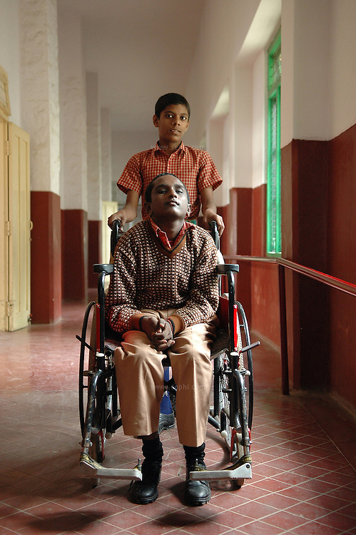 Deepak (14) in his wheel chair, and his friend Tabrez at APD School in Bangalore. Deepak is suffering from Neurological condition (with Datarating ataxia) and has been attending APD school for thee years. Tabrez has light polio and his calipers are at the repair shop at the moment.