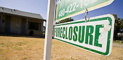 27 OCTOBER 2008 -- PHOENIX, AZ: A foreclosure sign in front of a home in Phoenix, AZ. The housing bust has hit Phoenix hard. Home prices are down by as much as 33 percent in some areas of the Phoenix metro area. Foreclosure sales make up half of the home resales in some parts of the metro area.  Photo by Jack Kurtz / ZUMA Press