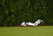 Center fielder David DeJesus #9 of the Chicago Cubs dives for but cannot get to an RBI double hit by Jason Kubel #13 of the Arizona Diamondbacks scoring Didi Gregorius #1, Paul Goldschmidt #44 and Martin Prado #14 during the seventh inning at Wrigley Field on June 1, 2013 in Chicago, Illinois.  (Getty Images)