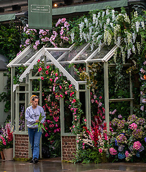 "© Licensed to London News Pictures. 02/07/2020. London, UK. Final touches to the wall of flowers at the Ivy Chelsea Garden restaurant on the King's Road in Chelsea as cafes, restaurants, pubs and hairdressers, get ready for ""Super Saturday"" after the Prime Minister Boris Johnson gave the go ahead in his statement last week. Photo credit: Alex Lentati/LNP"