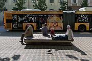 Bus passengers await the next service on Slovenska Cesta street in the Slovenian capital, Ljubljana, on 25th June 2018, in Ljubljana, Slovenia. Ljubljana city buses are operated by the Ljubljanski potniški promet LPP public utility company.