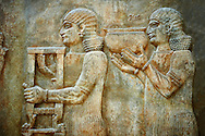 Stone relief sculptured panel of two servants. Facade L. Inv AO 19879 from Dur Sharrukin the palace of Assyrian king Sargon II at Khorsabad, 713-706 BC.  Louvre Museum Room 4 , Paris .<br /> <br /> If you prefer to buy from our ALAMY PHOTO LIBRARY  Collection visit : https://www.alamy.com/portfolio/paul-williams-funkystock/ancient-assyria-antiquities.html  Refine search by adding background colour, place, subject, museum etc into the LOWER SEARCH WITHIN GALLERY box to <br /> <br /> Visit our ANCIENT WORLD PHOTO COLLECTIONS for more photos to download or buy as wall art prints https://funkystock.photoshelter.com/gallery-collection/Ancient-World-Art-Antiquities-Historic-Sites-Pictures-Images-of/C00006u26yqSkDOM