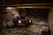 Q-bot, underfloor insulation reducing carbon emissions potentially for 12 million households in the UK.   Q-Bot allows under-floor insulation to be installed at a much lower cost and without the disruption of existing methods by using a small robot that goes under the floor instead of having to take the floor up. © Andy Aitchison/ Ashden