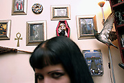 Emma Smith, 21, is sitting on a sofa in Cecileís living room on Sunday, 15 October, 2006, in Camden Town, London, England. The Vampyre Connexion is the largest and most active of all the vampire groups in the United Kingdom, counting more than 100 members that for years have gathered regularly in London to share their common love for vampires and the Dark side of life. The Connexion raised from the hashes of the Vampyre Society, the first vampire appreciation group in 1995. The group believe in the fantasy of vampires and such creatures and live it to the full. Its  roots are to be found in the legends of Bram Stokerís Dracula. The group prints its own magazine, ëDark Nightsí featuring drawings, poetry, stories, photography and events. All of the members dress very peculiar clothing, and this is a very important part of the life of the group; it is respected with pride, taste and accuracy for the detail. Most like to dress to be elegant in a range of styles from regency to Victorian, some sew their own. In addition members visit art galleries, cemeteries, churches and cathedrals, attend gigs and concerts, and hold their own parties throughout the year, Halloween being the biggest and scariest one. Membership is open to all, the only qualification: being a love of all things Vampyric. **ItalyOut**