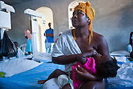 Adrevile Elimene breastfeeds her baby though she has cholera so both are kept in cholera clinc for observation. The Real Hope for Haiti  Cholera Clinic in Cazel is 11 kilometers off the main road passing through Cabaret, north of Port-au-Prince is run by missionaries.