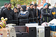 Immigrant workers and locals at auction in Boston marketplace<br /><br />Boston had the highest proportion of votes for Brexit in mainland UK. Boston in Lincolnshire was once a sleepy rural town. Since early the 21st century a large influx of economic migrants mainly from Eastern Europe have found work across Lincolnshire, working for the minimum wage in agricultural and construction industries, doing jobs that locals don't to do. Towns have expanded sometimes by 10% during this period. British business needs the migrant workers to survive, but but local people voted the highest proportion for Brexit, 75% against 'Remain', in a protest vote against migrant workers.