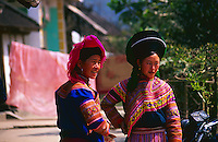 Two Flower Hmong women chatting outside a restaurant in a small town in Northern Vietnam.