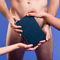 Nude male torso, covered with a book, held in many hands. Implying all sorts of controversial ideas, depending on your own wishes. Is it a Bible or other religious tome? Is it Darwin's On the Origin of Species? What about The Genesis Flood? Other titles come to mind? It's a blank cover, ready to tell your story. This image was an unused concept for a production of The Most Fabulous Story.