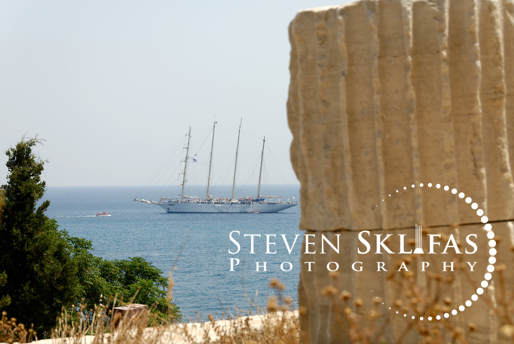 Greece. Samos.  View of a ship sailing near ruins of the old Byzantine castle Kastro in the town of Pythagoreio. The Kastro was reinforced with new buildings in order to serve the needs of the Struggle for independence and is named after Lykourgos Logothetis, the local chieftain who organised a decisive naval victory over the Turks on August 6 1824. The town's cemetery is beside the Kastro as is the church of Metamorfosis, built to celebrate the victory. Also in the Kastro grounds are ruins of two opulent villas of the Hellenistic period (2nd BC), Roman galleries and the remains of a 5th century Christian Basilica.  The Kastro is in the pretty seaside town of Pythagorio which is a UNESCO Cultural World Heritage Site and is named after the great philosopher Pythaogaras who was born here in 580 BC.