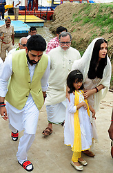 August 5, 2017 - Allahabad, Uttar Pradesh, India - Allahabad: Bollywood actor Abhishek Bachchan (L) walks along his wife, actress Aishwarya Rai Bachchan (R) and their daughter Aaradhya Bachchan after immersing ashes of her father Krishnaraj Rai in the river Ganga at Sangam, in Allahabad on August 5, 2017. (Credit Image: © Prabhat Kumar Verma via ZUMA Wire)
