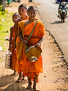 27 FEBRUARY 2015 - PONHEA LEU, KANDAL, CAMBODIA: Buddhist novices, boys who enter the monastery during their school break, go out on the morning alms round in Kandal province, Cambodia.    PHOTO BY JACK KURTZ