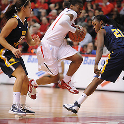 Rutgers Scarlet Knights guard Erica Wheeler (3) drives into the paint against West Virginia Mountaineers guard Vanessa House (12) and guard/forward Korinne Campbell (21) during first half Big East NCAA women's basketball action between Rutgers and West Virginia at the Louis Brown Rutgers Athletic Center