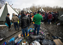 © Licensed to London News Pictures. 23/01/2016. Dunkirk, France. Leader of the Labour Party JEREMY CORBYN meets migrants during a visit to a temporary camp in Dunkirk, France, where thousands of migrants and refugees attempting to reach the UK are currently living. Photo credit: Ben Cawthra/LNP