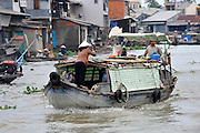 Boat on Mekong River.  Cai Be, Tien Giang Province, Vietnam