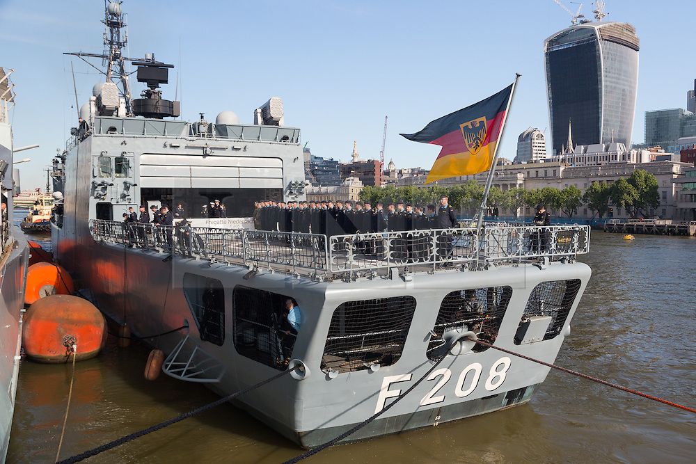 © Licensed to London News Pictures. 21/05/2014. London, UK. German frigate, FGS Niedersachsen F208 arrives in sunshine under Tower Bridge in London on 21st May 2014 and moors next to HMS Belfast on the River Thames. FGS Niedersachsen is a Bremen-class frigate belonging to the German Navy and measures 130m in length. Photo credit : Vickie Flores/LNP