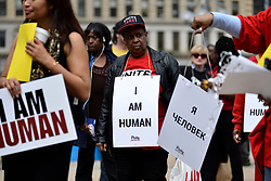 April 4, 2017 - Philadelphia, Pennsyvlania, United States - Signs reading ''I AM HUMAN'' in various languages are handed out to protesters gathered in Philadelphia, PA, on April 4, 2017. In cities around the nation people gather to commemorate the 49th anniversary of the assassination of Rev. Dr. Martin Luther King. (Credit Image: © Bastiaan Slabbers/NurPhoto via ZUMA Press)